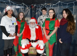 Some of Team Renaissance in their Santa's Grotto with Carers in Hertfordshire Fundraising Manager Linda Cudmore